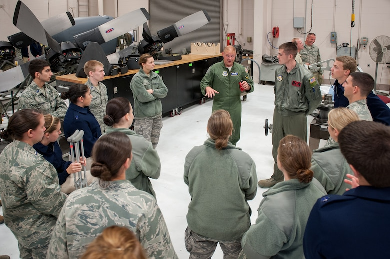 Capt. Josh Ketterer, a C-130 Hercules pilot from the 165th Airlift Squadron, talks about principles of flight with U.S. Air Force Reserve Officer Training Corps cadets during a tour of the Kentucky Air National Guard Base in Louisville, Ky., Nov. 19, 2013. The cadets are assigned to Detachment 295, which is based at the University of Louisville. (U.S. Air National Guard photo by Maj. Dale Greer)