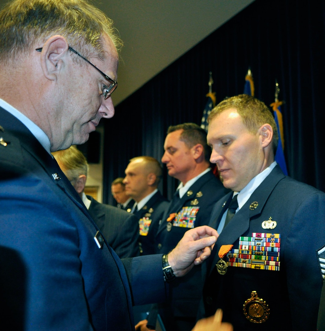 Master Sgt. Clinton Dudley, right, receives the Air Force Combat Action Medal from Nevada Adjutant General Brig. Gen. William Burks on Dec. 5. (Photo by