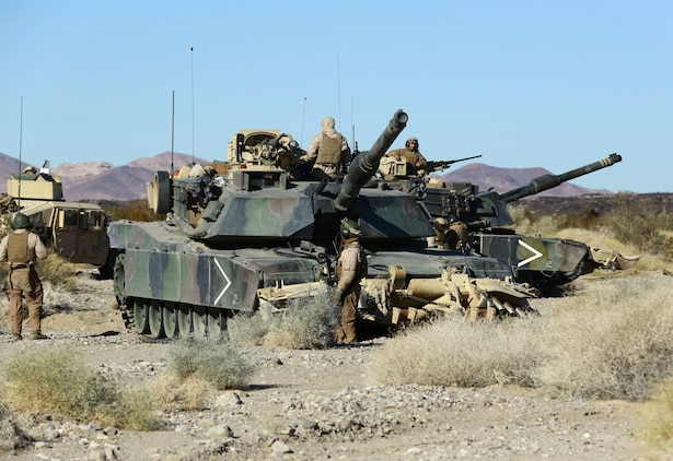 Marines with 1st Tank Battalion perform a final check on their M1A2	 Abrams tank before beginning a mechanized raid in support of Exercise Steel Knight 2014 at Marine Corps Air Ground Combat Center Twentynine Palms, Calif., Dec. 13, 2013. The assault utilized both air and ground elements to eliminate their objective. Steel Knight is an annual exercise that includes elements from the entire I Marine Expeditionary Force (MEF). The exercise focuses on conventional operations and provides realistic training that prepares Marines for overseas operations. (U.S. Marine Corps photo by Cpl. James Gulliver/Released)
