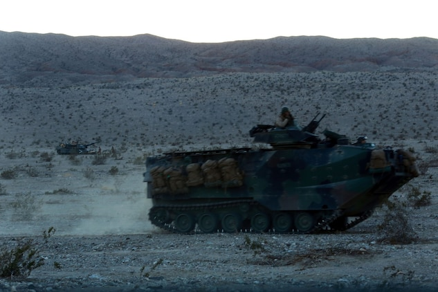 Marines with Alpha Company, 1st Battalion, 5th Marine Regiment, provide suppressing fire during a mechanized raid in support of Exercise Steel Knight 2014 at Marine Corps Air Ground Combat Center Twentynine Palms, Calif., Dec. 13, 2013. The battalion played a vital role in the ground combat element during the assault which prepared them for their upcoming deployment to Australia. Steel Knight is an annual exercise that includes elements from the entire I Marine Expeditionary Force (MEF). The exercise focuses on conventional operations and provides realistic training that prepares Marines for overseas operations. (U.S. Marine Corps photo by Cpl. James Gulliver/Released)