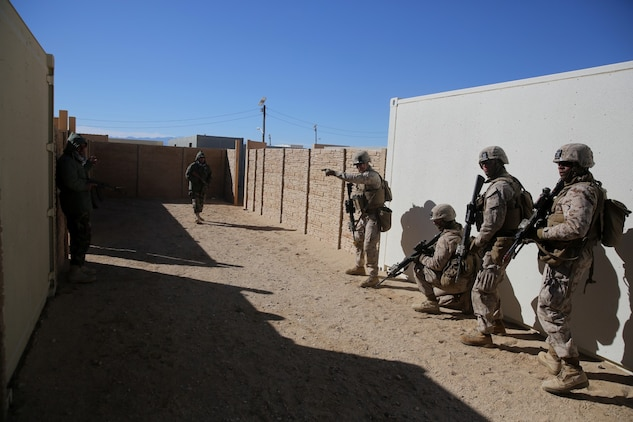 Lance Cpl. Ben Knipp, center, team leader, Bravo Company, 1st Battalion, 7th Marine Regiment, and a native of Englewood, Ohio, prepares his team to breach a compound during a counterinsurgency exercise on Range 220 at Marine Corps Air Ground Combat Center Twentynine Palms, Calif., Dec. 9, 2013. The $140 million urban warfare training facility consists of more than 1,000 buildings and is divided into four sectors. The buildings replicate what can be found in an urban town to include gas stations, factories, one story complexes, marketplaces and multiple story buildings. The battalion is slated to continue a vigorous training schedule before deploying to Afghanistan this spring.