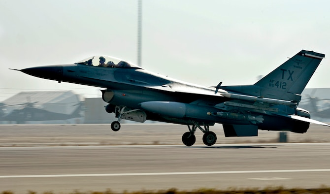 The first F-16 Fighting Falcon arrives Dec. 15, 2013, at Bagram Airfield, Afghanistan. The F-16's transitioned from Kandahar, Afghanistan, to Bagram once the main runway was renovated and extended to meet the demand of the different aircraft. (U.S. Air Force photo/Senior Airman Kayla Newman)