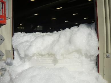 """""""Hangar at Holloman AFB after a foam dump test"""" Photo by Daniel Garcia."""