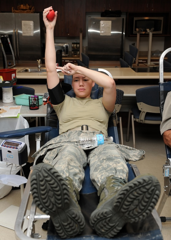Staff Sgt. Kimberly Miles, 460th Space Wing chaplain assistant, holds her arm up to help stop bleeding after her blood donation Dec. 19, 2013, at the health and wellness center on Buckley Air Force Base, Colo. According to the American Red Cross, an estimated 38 percent of the U.S. population is eligible to donate but less than 10 percent do each year. (U.S. Air Force photo by Senior Airman Marcy Copeland/Released)