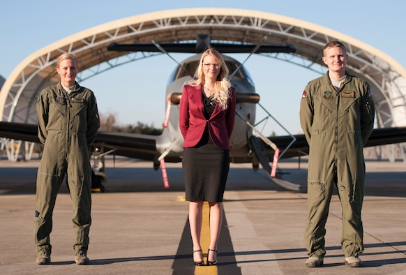 Senior Airman Rebecca Stinson, 711th Special Operations Squadron loadmaster, Jordan Roby, 1st Special Operations Contracting Squadron contract specialist, and Capt. Joshua Stinson, 34th Special Operations Squadron U-28A instructor pilot, pose for a photo at Hurlburt Field, Fla., Dec. 18, 2013. The three family members serve within Air Force Special Operations Command as respective enlisted, civilian and commissioned Air Commandos. (U.S. Air Force photo/Senior Airman Krystal Garrett)