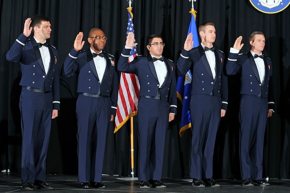 Left to right: Kaleb Jenkins, Adetunji Fiyaso, Christopher De La Torre, Spencer Boone and David Baska are sworn in as second lieutenants during the fall semester graduation in Arnold Hall Wednesday./U.S. Air Force photo by Sarah Chambers.