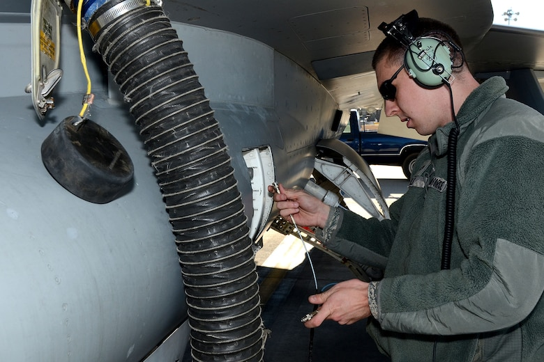 U.S. Air Force Senior Airman Earl Sale, with the 495th Fighter Group, Det. 157, 169th Aircraft Maintenance Squadron avionics shop at McEntire Joint National Guard Base, South Carolina Air National Guard, sets up the Joint Service Electronic Combat Systems Tester to an F-16 Fighting Falcon, Dec. 11, 2013. The JSECST is a 180-day preventative maintenance practice that performs a confidence test of the radar threat warning system in the jet.  (U.S. Air National Guard photo by Tech. Sgt. Caycee Watson/Released)