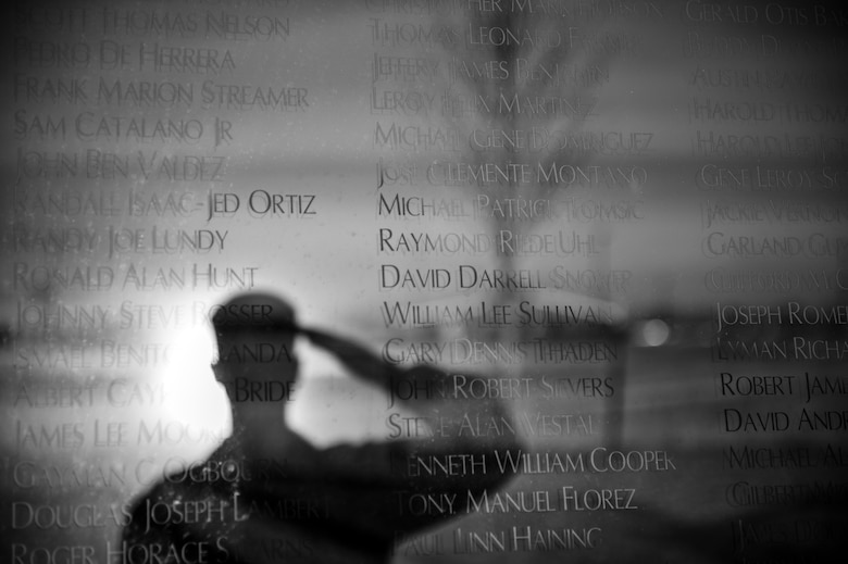 An Airman renders a salute to the names of fallen and missing in action Colorado veterans at the Colorado Freedom Memorial Dec. 12, 2013, in Springhill Community Park in Aurora, Colo. The Colorado Freedom Memorial is the first monument in the country to honor all service members from one state who were killed or missing in action from the Spanish-American war to the present. (U.S. Air Force photo by Senior Airman Riley Johnson/Released)