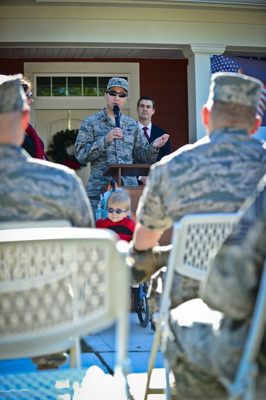 Col. Scott DeThomas, 6th Air Mobility Wing commander, addresses a crowd at MacDill Air Force Base's Americans with Disabilities Act home unveiling, Dec. 18, 2013. The base recently completed a series of 10 new ADA home builds.  (U.S. Air Force photo by Staff Sgt. Brandon Shapiro/Released)