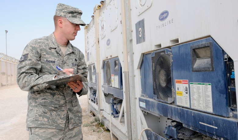 Staff Sgt. Jesse Tucker checks the temperature of a connex freezer at the 379th Air Expeditionary Wing in Southwest Asia, Dec. 17, 2013. The connex freezer is used to keep food products at the appropriate temperature and prevent it from s. Tucker is a 379th Expeditionary Force Support Squadron member deployed from Hurlburt Field, Fla., and a Navarre, Fla., native. (U.S. Air Force photo/Senior Airman Hannah Landeros)