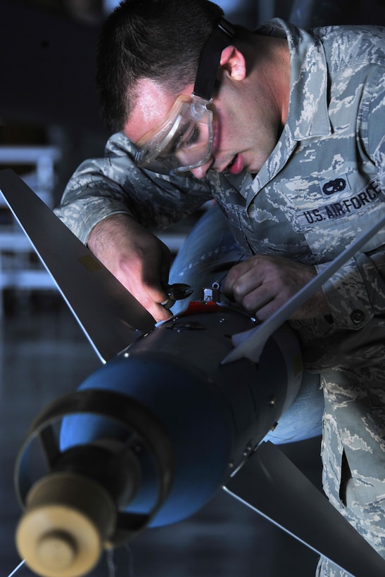Airman 1st Class Russell Voyles prepares a missile on an F-16 Fighting Falcon during a load crew competition Dec. 13, 2013, at Shaw Air Force Base, S.C. Voyles is a 20th Aircraft Maintenance Squadron weapons load crew member. (U.S. Air Force photo/Airman 1st Class Jensen Stidham)