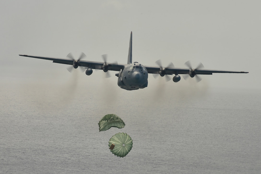 A C-130 Hercules airdrops supplies to Micronesian islanders during Operation Christmas Drop Dec. 16, 2013, near Andersen Air Force Base, Guam. This year marks the 62nd year of Operation Christmas Drop, which began in 1952, making it the world's longest-running airdrop mission. Every December, C-130 crews from the 374th Airlift Wing at Yokota Air Base, Japan, partner with the 36th Wing Airmen at Andersen AFB to airlift food, supplies and toys to islanders throughout Micronesia. (U.S. Air Force photo/2nd Lt. Jake Bailey)