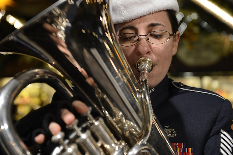 "Tech. Sgt. Meredith Helay performs holiday music at a Weihnachtsmarkt Dec. 17, 2013, in Trier Germany. The U.S. Air Forces in Europe Five Star Brass ensemble performed more than 15 German and American holiday classics like ""O Tannenbaum"" and ""We Wish You a Merry Christmas."" Helay is a USAFE band euphonium player from Canton, Conn. (U.S. Air Force photo/Staff Sgt. Christopher Ruano)"