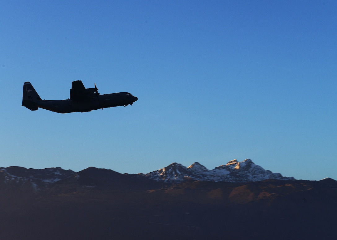 A C-130 Hercules takes off from the flightline carrying both Army and Air Force paratroopers, Dec. 11, 2013, at Aviano Air Base, Italy. The Hercules is the prime transport for airdropping troops and equipment into hostile areas. (U.S. Air Force photo/Airman Ryan Conroy)
