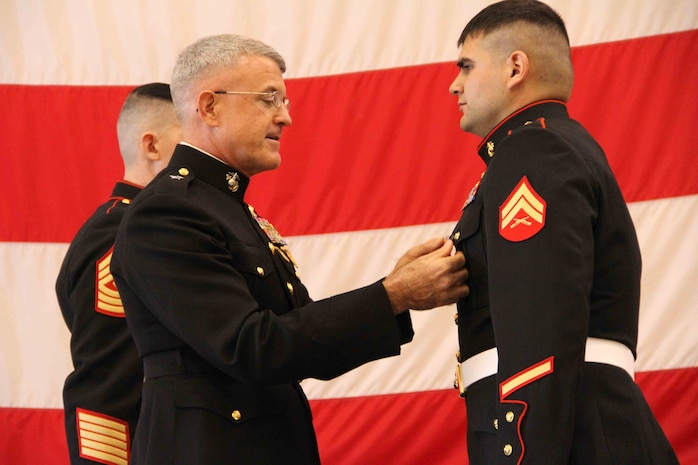 Cpl. Ethan Nagel, a Prior Lake, Minn. native, receives the Silver Star from Brigadier General James S. Hartsell, commanding general of the 4th Marine Division, Dec. 17, for his actions in Afghanistan.