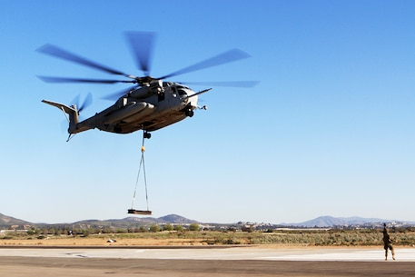 "A CH-53E Super Stallion with Marine Heavy Helicopter Squadron 466, ""Wolfpack,"" 3rd Marine Aircraft Wing, practices external lifts aboard Marine Corps Air Station Miramar, Calif., Feb. 28. The Super Stallion is toting a 6,200-pound load from a single-point sling, simulating external cargo transport as it would occur in areas of operation such as Afghanistan."