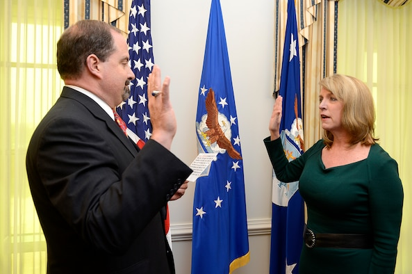 Timothy Beyland (left) swears in Deborah Lee James as the 23rd Air Force secretary Dec. 20, 2013, at the Pentagon. James is responsible for the affairs of the Department of the Air Force, including the organizing, training, equipping and providing for the welfare of its more than 690,000 active-duty, Guard, Reserve and civilian Airmen and their families. Beyland is the administrative assistant to the secretary of the Air Force. (U.S. Air Force photo/Scott M. Ash)
