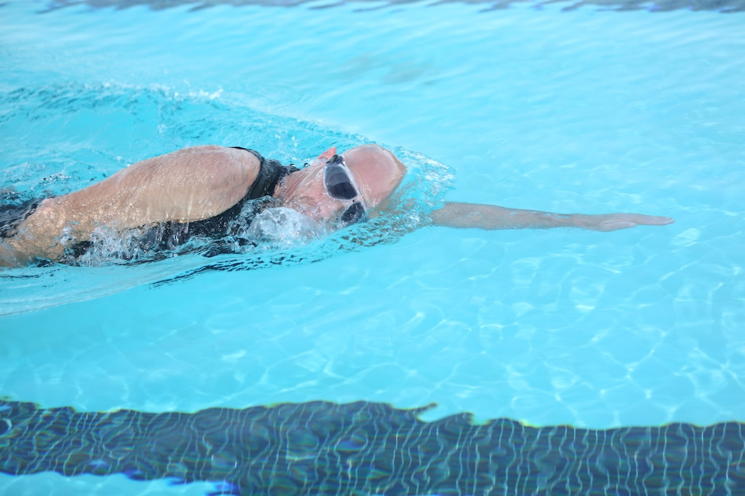 Don Tolbert, systems integration officer, Marine Corps Communication-Electronics School, underwent an 8-mile swim at the Training Tank during the early hours of Dec. 19 to work toward increasing his personal standards in swimming endurance.
