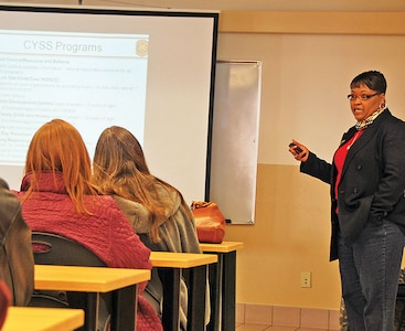 Sonya Douglas, coordinator, CYSS, speaks to educators from K-State about programs, facilities and other resources available for military dependents at Fort Riley during a Dec. 6 visit to the teen center.  Photo by: Julie Fiedler, POST.