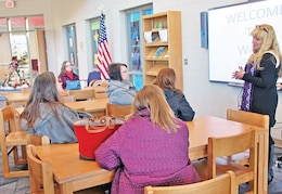 Deb Gustafson, principal, Ware, discusses challenges of education in a military community with a group of educators from K-State during a Dec. 6 visit to Fort Riley.  Photo by: Julie Fiedler, POST.