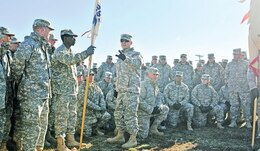 Maj. Gen. Paul E. Funk II, commanding general, 1st Inf. Div. and Fort Riley, center, speaks to Soldiers of 299th BSB during a Nov. 26 awards ceremony on Custer Hill.  Photo by: Sgt. Daniel Stoutamire, 2ND ABCT.