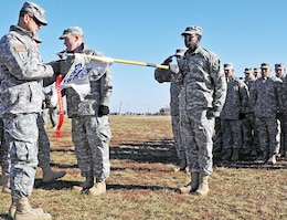 Maj. Gen. Paul E. Funk II, commanding general, 1st Inf. Div. and Fort Riley, left, presents a red SABER streamer to Co. A, 299th BSB, during a Nov. 26 awards ceremony on Custer Hill. Funk presented the 299th BSB with the streamer for its efforts in becoming the first battalion to have zero drug and alcohol-related incidents within the quarter. The 299th BSB was the first battalion-sized unit in 1st Inf. Div.'s history to earn the red SABER streamers.  Photo by: Sgt. Daniel Stoutamire, 2ND ABCT.
