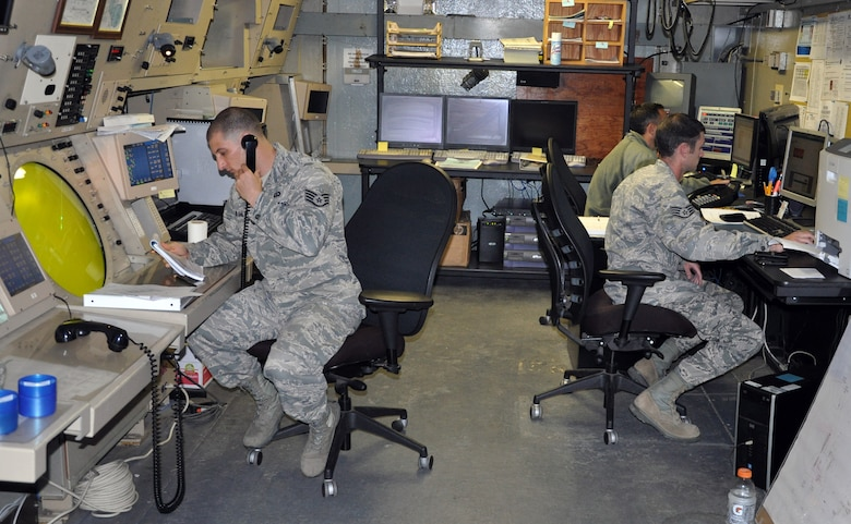 U.S. Air Force Air Traffic Controllers assigned to the 612th Air Base Squadron, Joint Task Force-Bravo, work at the Ground Control Approach (GCA) facility, Soto Cano Air Base, Honduras, Dec. 19, 2013. Airmen who work in the GCA facility are responsible for directing air traffic around the base, to include aircraft sequencing, issuing safety and traffic alerts, and maintaining aircraft separation. (U.S. Air Force photo by Capt. Zach Anderson)