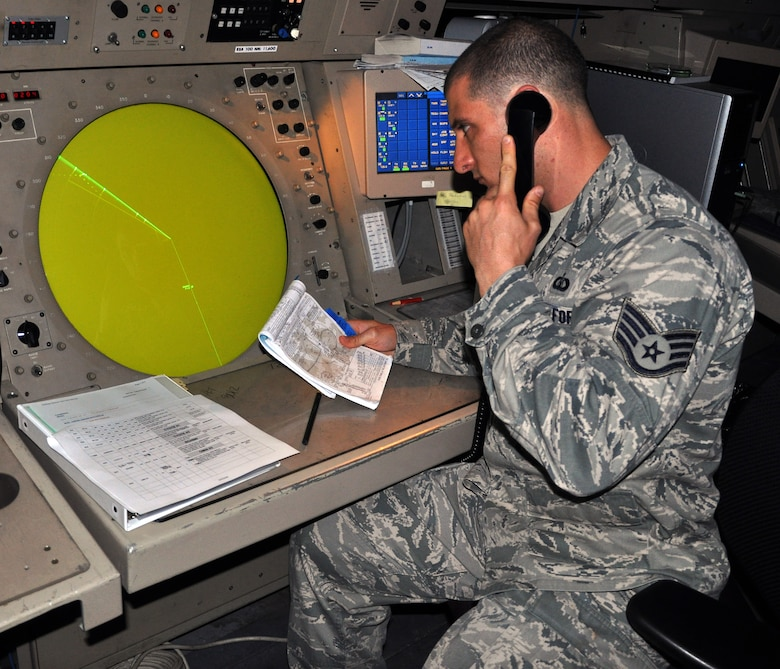 U.S. Air Force Staff Sgt. Rocco DeSalvo, an Air Traffic Control Ground Control Approach (GCA) watch supervisor assigned to the 612th Air Base Squadron, Joint Task Force-Bravo, works at the scope of a TPN-19 radar at the GCA facility, Soto Cano Air Base, Honduras, Dec. 19, 2013. Airmen who work in the GCA facility are responsible for directing air traffic around the base, to include aircraft sequencing, issuing safety and traffic alerts, and maintaining aircraft separation. (U.S. Air Force photo by Capt. Zach Anderson)