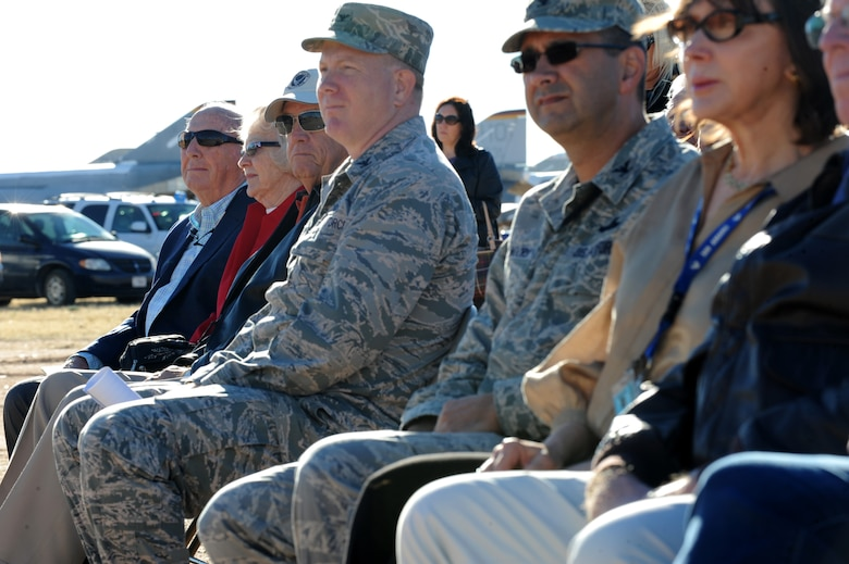 Retired U.S. Air Force General Earl O'Loughlin, left, watches as a B-52G is cut into pieces at the 309th Aerospace Maintenance and Regeneration Group, Davis-Monthan Air Force Base, Ariz., Dec. 19, 2013. O'Loughlin was a B-25 Instructor pilot from 1965 -1968 for the 379th  Bombardment Wing at Wurtsmith Air Force Base, Mich., which is now decommissioned. (U.S Air Force photo by Staff Sgt. Angela Ruiz/released)