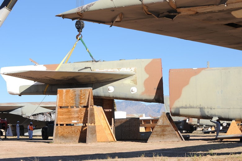 U.S. Air Force personnel from the 578th Storage and Disposal Squadron lift a B-52G's tail section onto a custom-made cradle at the 309th Aerospace Maintenance and Regeneration Group, Davis-Monthan Air Force Base, Ariz., Dec, 19, 2013. The cradle is purposely placed 30 degrees off center and a minimum of six feet apart from the aircraft's fuselage in order for Russia's satellites to verify the elimination. (U.S Air Force photo by Staff Sgt. Angela Ruiz/released)