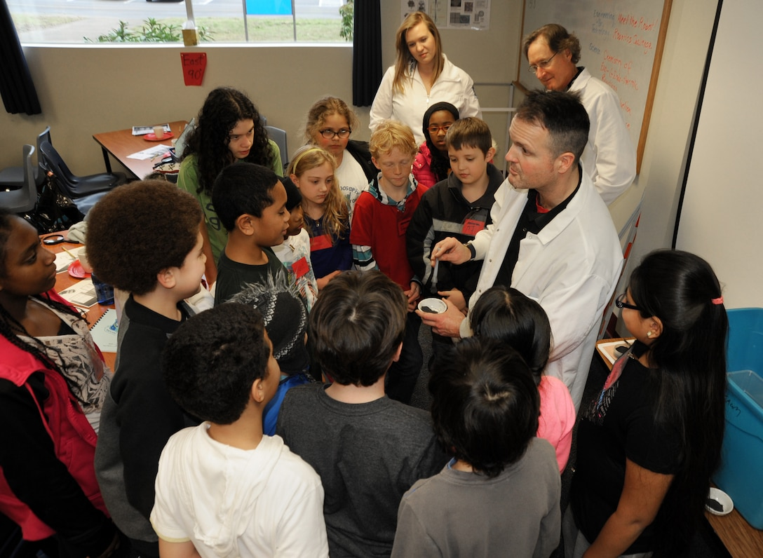 Jon Dyer, a State of Oregon Forensic Scientist, gives detailed instructions on a finger print experiment to a student group from Chief Joseph-Ockley Green Elementary School in Portland, Ore., Dec. 16, 2013. STARBASE Academies help teach more than 75,000 students nationally each year in math and science education. (Air National Guard photo by Tech. Sgt. John Hughel, 142nd Fighter Wing Public Affairs/Released)