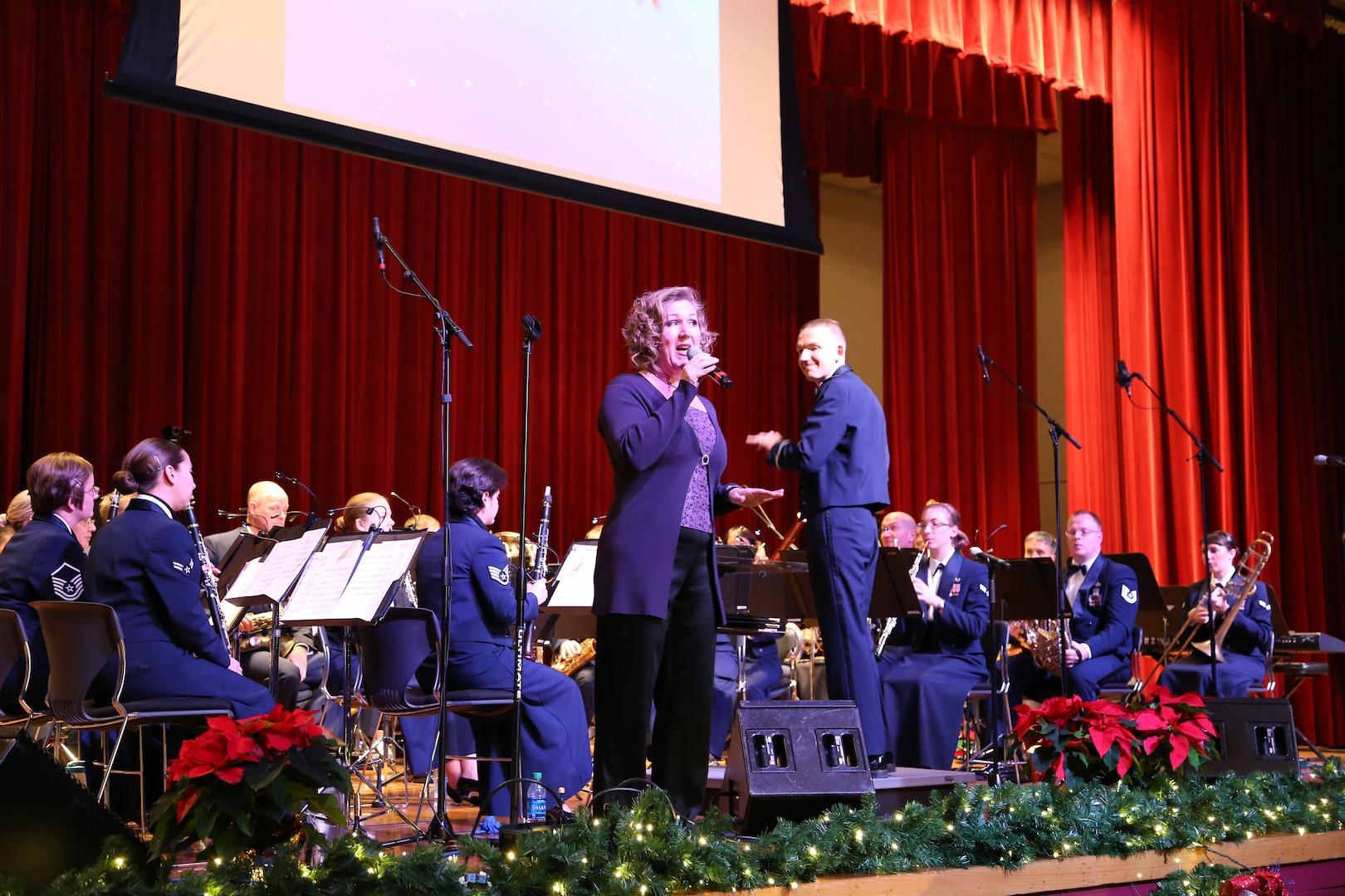 Air Force Master Sgt. Nancy Poffenbarger, Air Force Band of the West vocalist, sings a variety of holiday songs with members of the Air Force Band of the West Dec. 17 at the Joint Base San Antonio-Lackland Bob Hope Theater. (U.S. Air Force photo by Airman 1st Class Lincoln Korver)
