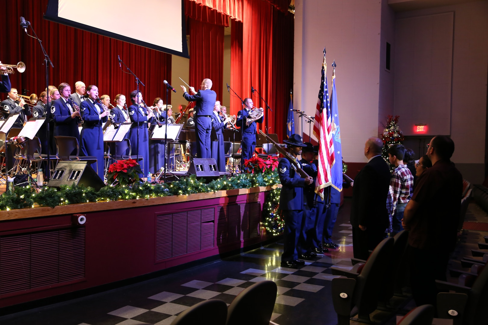 The Air Force Band of the West plays the Star Spangled Banner while military training instructors present the colors Dec. 17 at the Joint Base San Antonio-Lackland Bob Hope Theater. (U.S. Air Force photo by Airman 1st Class Lincoln Korver)