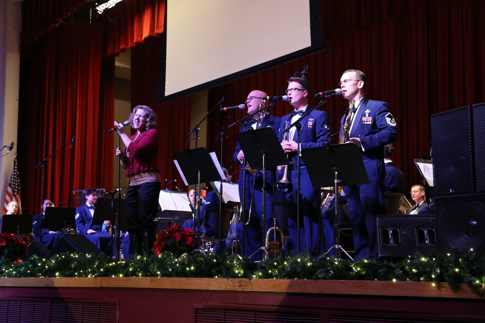 """Air Force Master Sgt. Nancy Poffenbarger, Air Force Band of the West vocalist, sings a variety of holiday songs with members of the Air Force Band of the West's musical ensemble """"Warhawk"""" Dec. 17 at the Joint Base San Antonio-Lackland Bob Hope Theater. (U.S. Air Force photo by Airman 1st Class Lincoln Korver)"""
