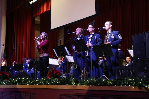 "Air Force Master Sgt. Nancy Poffenbarger, Air Force Band of the West vocalist, sings a variety of holiday songs with members of the Air Force Band of the West's musical ensemble ""Warhawk"" Dec. 17 at the Joint Base San Antonio-Lackland Bob Hope Theater. (U.S. Air Force photo by Airman 1st Class Lincoln Korver)"