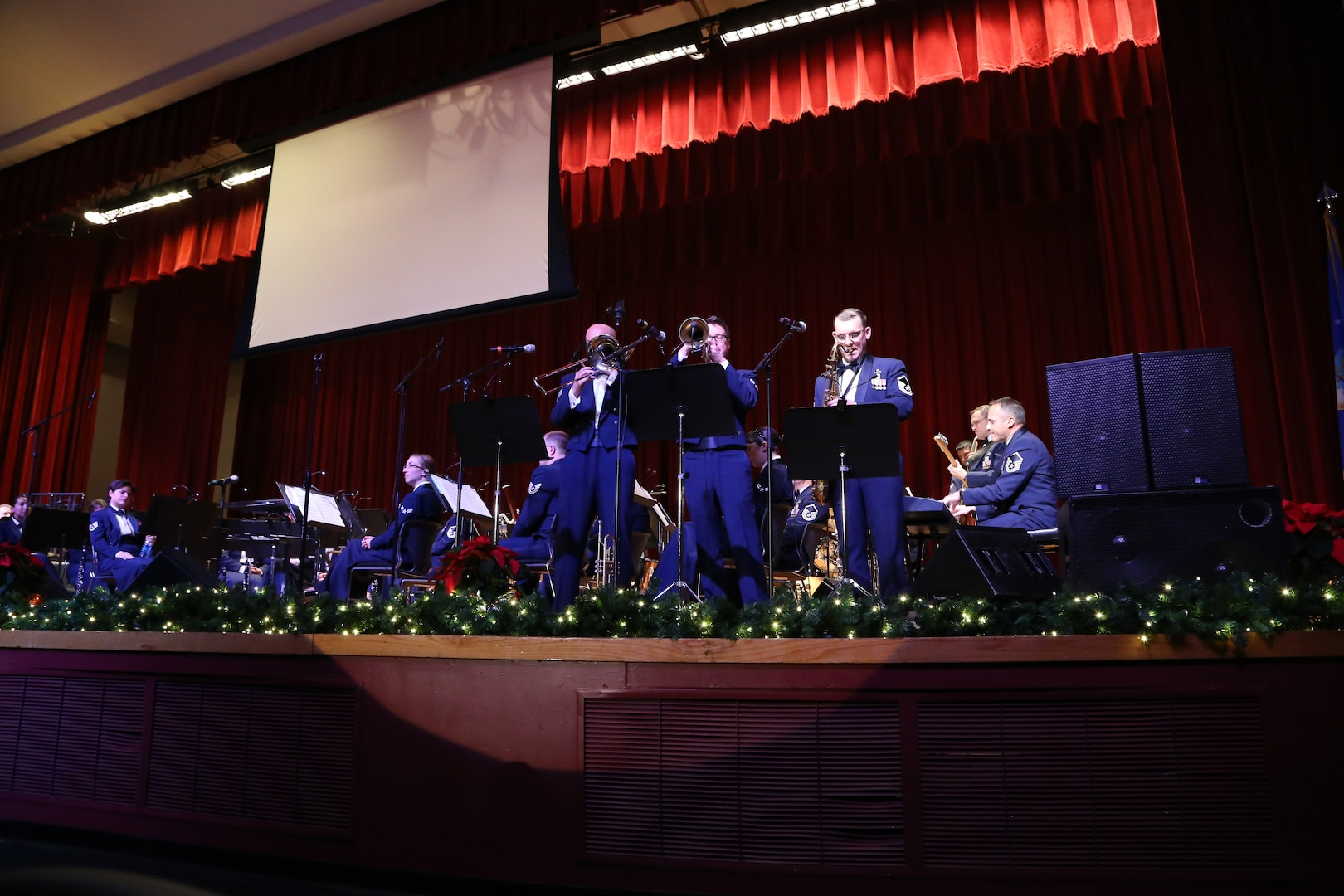 """Members of the Air Force Band of the West's musical ensemble """"Warhawk"""" play a variety of holiday songs Dec. 17 at the Joint Base San Antonio-Lackland Bob Hope Theater. (U.S. Air Force photo by Airman 1st Class Lincoln Korver)"""