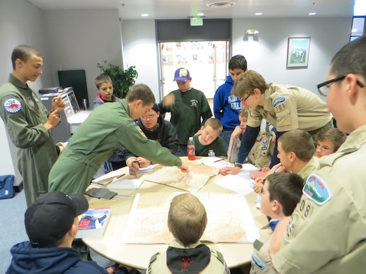 Cadets familiarize Boy Scouts with aviation maps during an aviation workshop at the Air Force Academy Dec. 7.