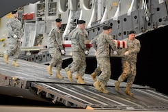 A U.S. Army carry team transfers the remains of Spc. Terry K. D. Gordon, of Shubata, Miss., during a dignified transfer Dec. 19, 2013 at Dover Air Force Base, Del. Gordon was assigned to the 1st Squadron, 6th Cavalry Regiment, 1st Combat Aviation Brigade, 1st Infantry Division, Fort Riley, Kan. (U.S. Air Force photo/Greg L. Davis)