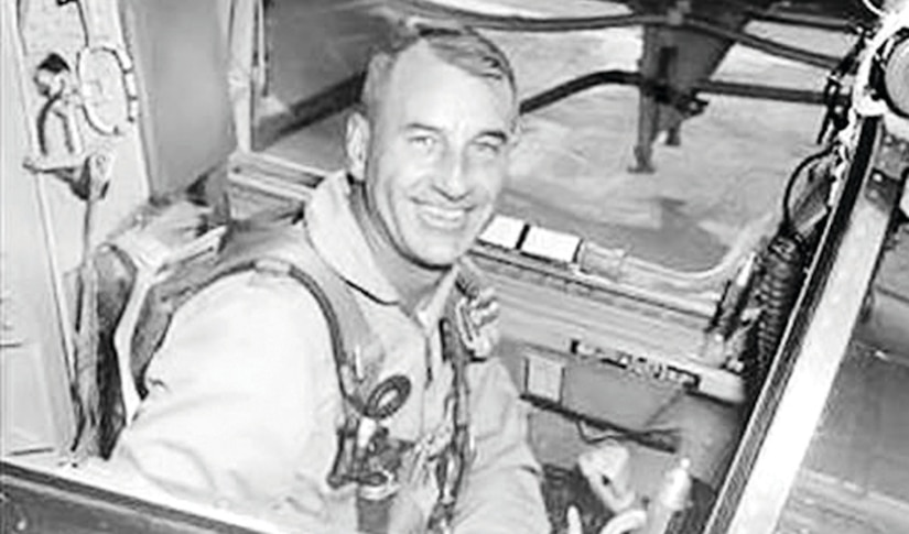 Air Force Col. Harry Shoup sits in the cockpit of a plane.