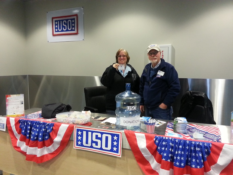 Ellen Jenkins and Ralph Nelson, United Service Organizations representatives, wait to greet incoming passengers in the 731st Air Mobility Squadron passenger terminal at Osan Air Base, Republic of Korea, Oct. 31, 2013. The USO and the 731st AMS have been in a unified partnership to support personnel as they transition in and out of the ROK since October 2012. (U.S. Air Force courtesy photo)