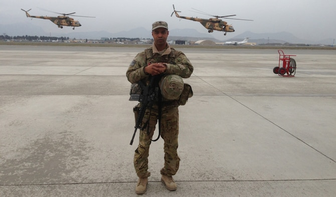 Lt. Col. Howard Gentry stands on the 438th Expeditionary Wing airfield in Kabul, Afghanistan, in 2012. Gentry volunteered for his first deployment because he wanted to make a difference, he said. (Courtesy photo)