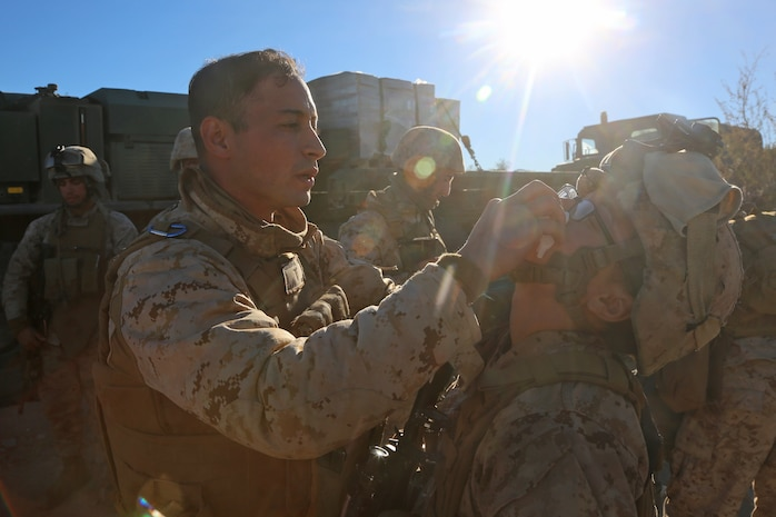 Petty Officer 3rd Class Moulay A. Bounouar, a corpsman with Combat Logistics Battalion 5, Combat Logistics Regiment 1, 1st Marine Logistics Group, provides basic first aid to a Marine during Exercise Steel Knight 2014 aboard Marine Corps Air Ground Combat Center Twentynine Palms, Calif., Dec. 13, 2013. The corpsmen with CLB-5 provided medical care for Marines and sailors and taught tactical combat casualty care classes to prepare them for deployment. SK14, which took place Dec. 09-16, is an annual exercise designed to prepare the 1st Marine Division for deployment with the Marine Air-Ground Task Force as the Ground Combat Element with the support of 1st MLG and 3rd Marine Air Wing. Combined, the MAGTF is able to deploy and respond in a timely manner to any situation across the globe.