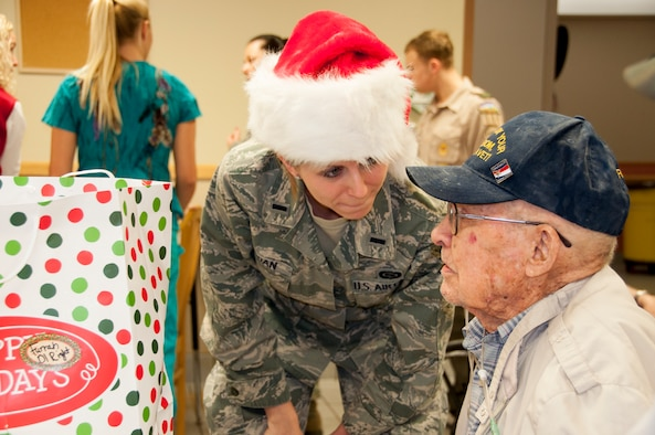 First Lieutenant Cristi Jordan, 507th Operations Group, listens to a veteran during the Norman Veterans Center Annual Christmas party, Dec. 23.  (U.S. Air Force Photo/Senior Airman Mark Hybers)