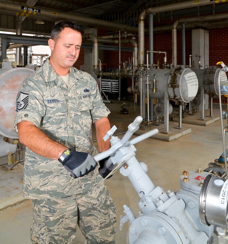 U.S Air Force Master Sgt. Bradley Barreth, a fuels technician with the 116th Logistics Readiness Squadron, Georgia Air National Guard, closes a valve at the   JP-8 bulk storage facility, Robins Air Force Base, Ga., Oct. 15, 2013.  Working as a dual-status civil service technician, Barreth is responsible for pumping the fuel that keeps the E-8C's flying as well as receiving, storing and accounting for petroleum products used by the wing.  (U.S. Air National Guard photo by Tech. Sgt. Regina Young/Released)