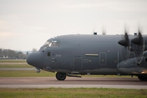 An MC-130J Commando II from the 67th Special Operations Squadron taxies during an exercise at RAF Fairford, England, Dec. 10, 2013. The exercise was designed to allow the 352nd Special Operations Group to practice and evaluate their ability to efficiently forward deploy the 352nd SOG's newest assets, the CV-22 Osprey and MC-130J. (U.S. Air Force photo by Staff Sgt. Stephen Linch/Released)