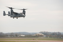 A CV-22 Osprey from the 7th Special Operations Squadron hovers during an exercise at RAF Fairford, England, Dec. 10, 2013. The 352nd Special Operations Group conducted an exercise involving approximately 130 Airmen and six aircraft at RAF Fairford from Dec. 9-12. The CV-22 Osprey is a tiltrotor aircraft that combines the vertical takeoff, hover and vertical landing capabilities of a helicopter with the long range, fuel efficiency and speed characteristics of a turboprop aircraft. (U.S. Air Force photo by Staff Sgt. Stephen Linch/Released)