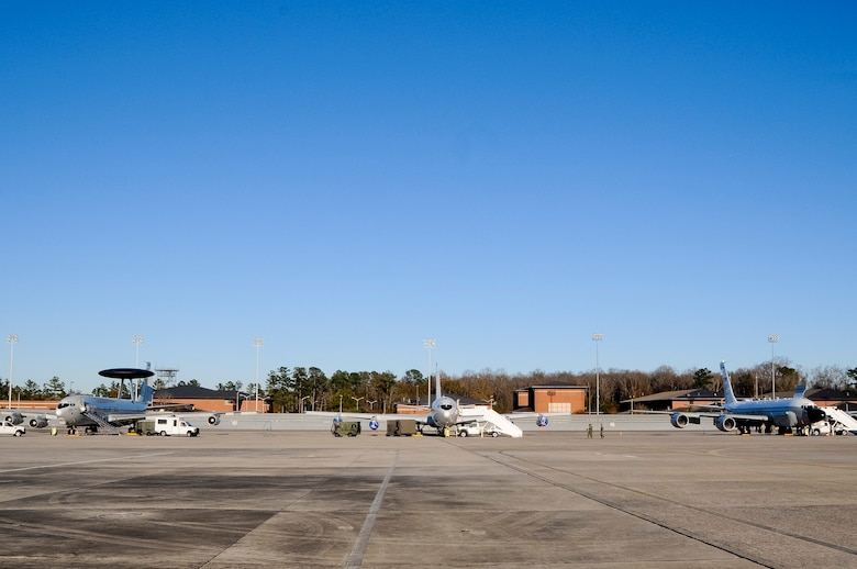 An E-3 Sentry AWACS, left, an E-8C Joint STARS and an RC-135 RIVETJOINT share a rare moment together on the flightline at Robins Air Force Base, Ga., Dec. 12, 2013. The three platforms, known as the Iron Triad, were at Robins to participate in a command and control (C2) joint force exercise hosted by Team JSTARS. The exercise was conducted to practice interoperability between multiple C2 platforms. (U.S. Air National Guard photos by Capt. Pamela Stauffer/Released)