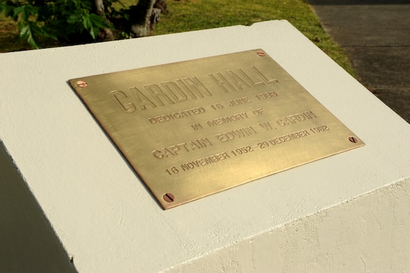 The Cardin Hall dedication plaque sits refurbished near Bldg. 3382 on Kadena Air Base, Japan, Dec. 20, 2013. The 18th Operations Support Squadron rededicated the building Dec. 20 as a remembrance and renewed commitment to honor the sacrifices of Capt. Edwin Cardin, who perished during a mid-air collision in 1982. (U.S. Air Force photo by Airman 1st Class Hailey R. Staker)