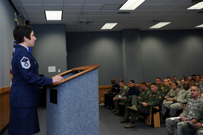U.S. Air Force Master Sgt. Kristin Dobson, 18th Operations Support Squadron, delivers a squadron history speech during the Cardin Hall rededication ceremony on Kadena Air Base, Japan, Dec. 20, 2013. Cardin Hall was dedicated June 16, 1983 in honor of Capt. Edwin Cardin who lost his life during a training mission in 1982. (U.S. Air Force photo by Airman 1st Class Hailey R. Staker)
