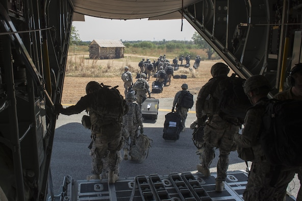 U.S. Soldiers, along with East Africa Response Force soldiers, depart a U.S. Air Force C-130 Hercules aircraft in Juba, Sudan, Dec. 18, 2013. The U.S. State Department requested the assistance of U.S. military forces in evacuating personnel from the embassy in Juba to Nairobi, Kenya, amid political and ethnic violence in South Sudan.